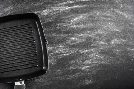cast iron: Cast iron griddle pan on black background Stock Photo