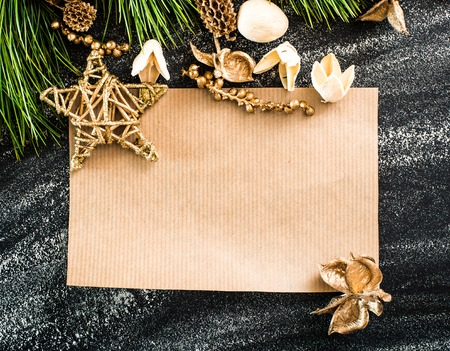 brown sheet of paper on a christmas background photo