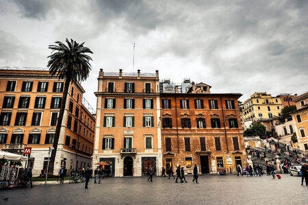 owes: Rome, Italy - November 17, 2014: Piazza di Spagna, is one of the most famous squares of Rome. It owes its name to the palace of Spain, Embassy of the Iberian is here Editorial