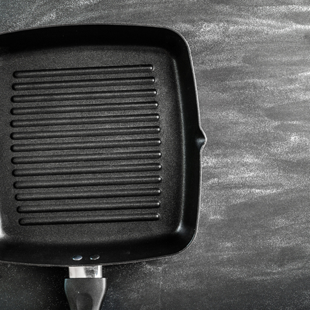 cast iron: Cast iron griddle pan on black background Stock Photo