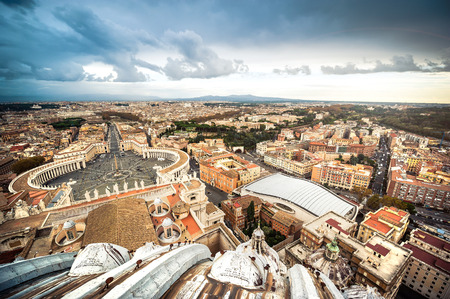 Famous Saint Peters Square in Vatican and aerial view of the city, Rome, Italy. photo