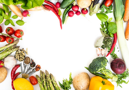 Vegetables in heart shape on a white background photo