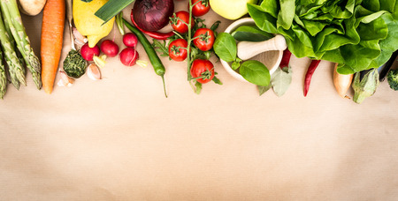 fruit bowl: Fresh vegetables on a brown background Stock Photo