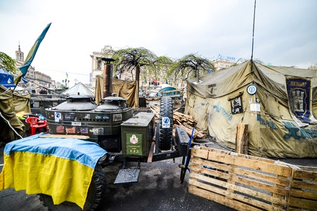 barricades: KIiev, Ukraine - April 14, 2014: Streets and barricades in the city center after the revolution in Kiev, Ukraine Editorial
