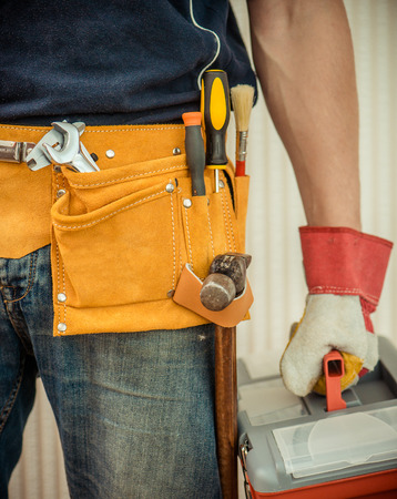 leathern: man with tools in leathern belt Stock Photo