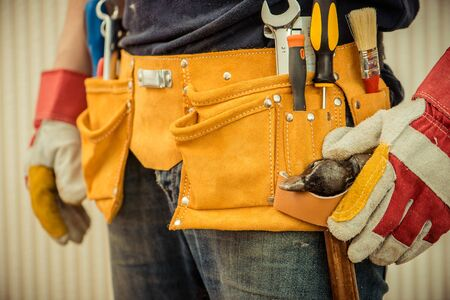 tools construction: man with tools in leathern belt Stock Photo