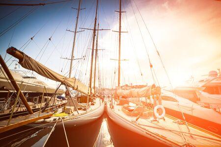 Beautiful marina view, sailboats and motorboats in port photo