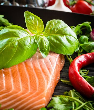 rukola: raw red fish with vegetables Stock Photo