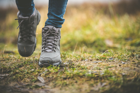 walk in the park: feet in shoes on a forest path Stock Photo