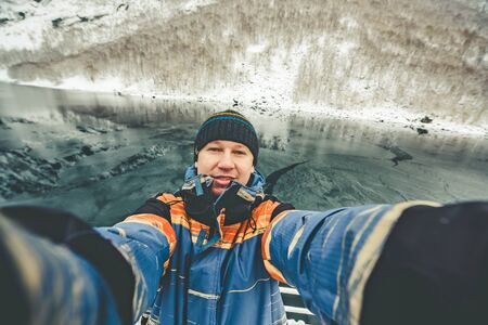 Seifie on beautiful mountain landscape with the Norwegian fjords in winter photo