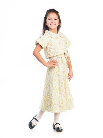 petite fille avec robe: Mignon petite fille dans une robe légère isolé sur fond blanc Banque d'images
