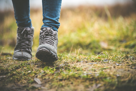 feet in shoes on a forest path Stock Photo