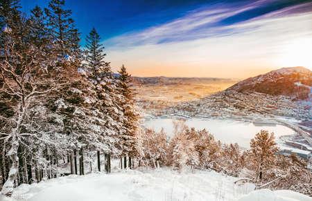 scandinavian landscape: portrait of a little girl in white winter hat