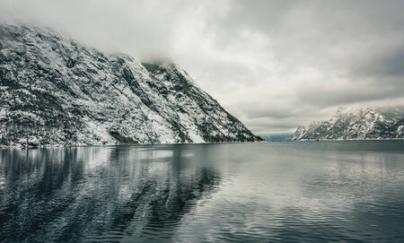 fjords: Beautiful mountain landscape with the Norwegian fjords in winter Stock Photo
