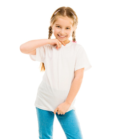 cute little girl in a white T-shirt and blue jeans on a white background shows a T-shirt on
