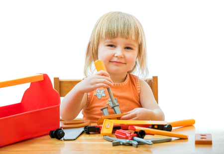 plier: cute little kid with toy tools isolated on a white background Stock Photo