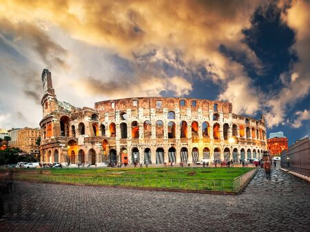 sunset city: Evening Colosseum is one of Romes most popular tourist attractions, Italy