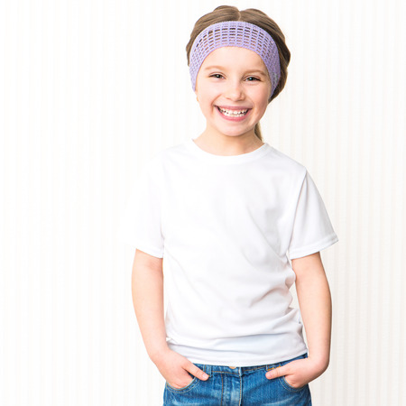 blank t shirt: Cute smiling little girl in white t-shirt Stock Photo