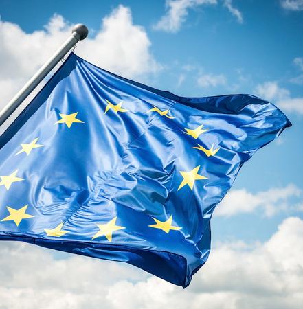 EU flag against blue sky 스톡 콘텐츠