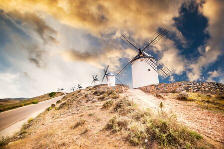 don: traditional windmills and castle in Consuegra  at sunset, Toledo, Spain