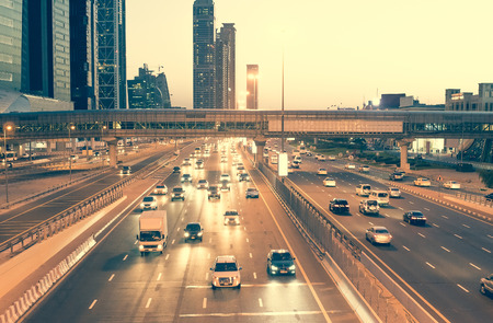 Skyscraper roads and bridge at the Sheikh Zayed Road in Dubai in the evening, United Arab Emirates