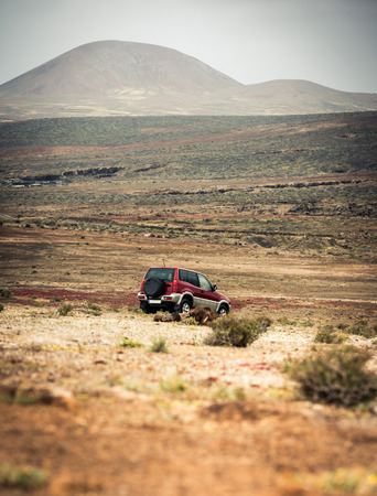 lanzarote: off-road car on the road against  a mountain landscape Stock Photo