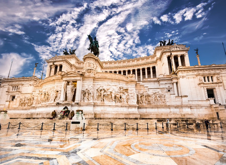 altar of fatherland: The Altare della Patria or Altar of the Fatherland against blue sky