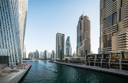 Panoramic view with modern skyscrapers and water channel of Dubai Marina, United Arab Emirates