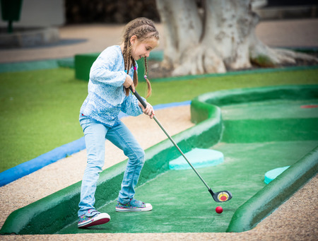playing golf: little girl playing golf outdoors