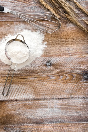 wooden texture: Sieve with flour on wooden board