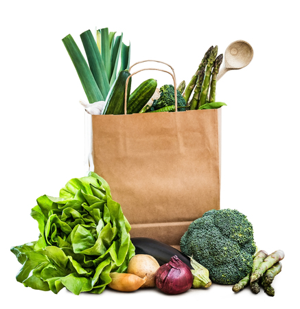 vegetables white background: fresh vegetables in a brown paper bag isolated on a white background