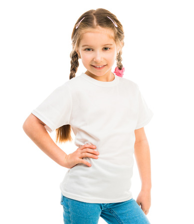 clothing model: cute little girl in a white T-shirt and blue jeans on a white background Stock Photo
