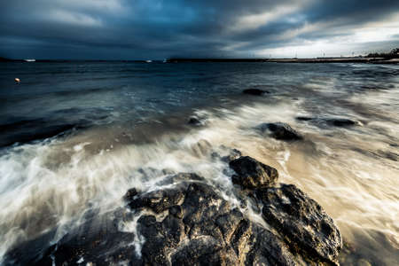 spellbinding: spellbinding dusk with dark blue sky at sea