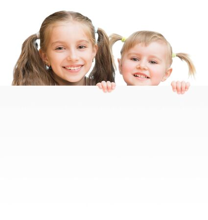 child holding sign: Beautiful sisters with  board isolated on a white background