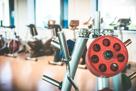 heavy weight: Rod and weights in the gym Stock Photo