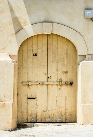 Wooden Garage Doors In A Street Of Valletta Historical Center