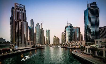water  panoramic: Dubai, United Arab Emirates - December 14, 2013: Panoramic view with modern skyscrapers and water channel of Dubai Marina in evening, United Arab Emirates Editorial