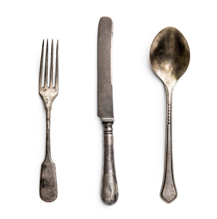 old metal fork with knife and spoon isolated on a white background
