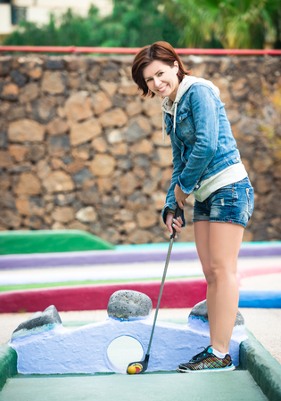 woman golf: cute young woman playing golf