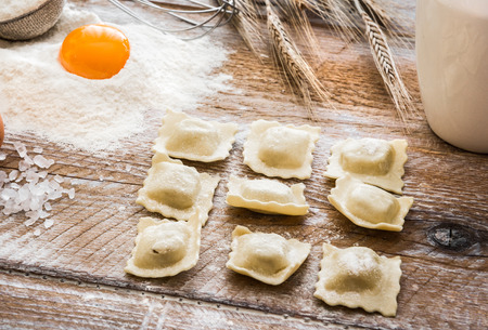 perle: Ravioli  and other products on wooden table Stock Photo