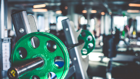 strength training: Rod with weights in the gym