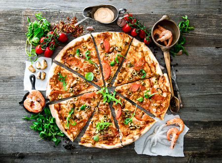 shrimp: delicious pizza with seafood on wooden table Stock Photo