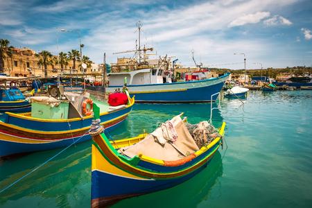 colorful fishing boat in the bay near Marsaxlokk in Malta Фото со стока