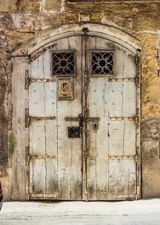 garage doors: wooden garage doors in a street of Valletta historical center in Malta