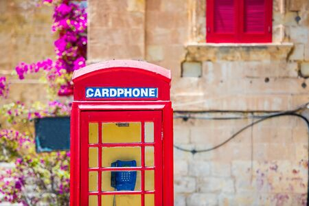 antique booth: red cardphone in a steet of Valletta in Malta