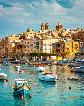 beautiful view on Birgu and the harbour with colorful boats in Malta