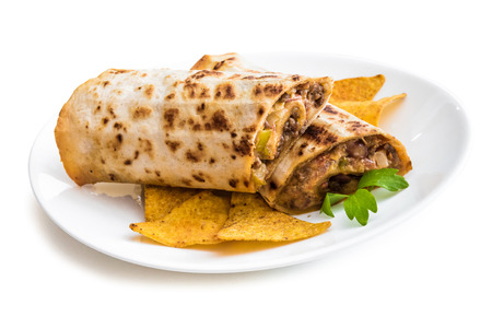 two and a half: two half of burrito with chips on plate isolated on a white background