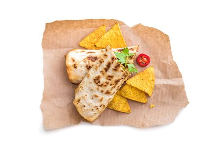 burrito: burrito with chips on parchment isolated on a white background