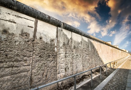 Remains of the Berlin Wall preserved along Bernauer Strasse at sunset