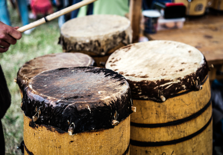 drums: old wooden ethnic drums outdoors Stock Photo